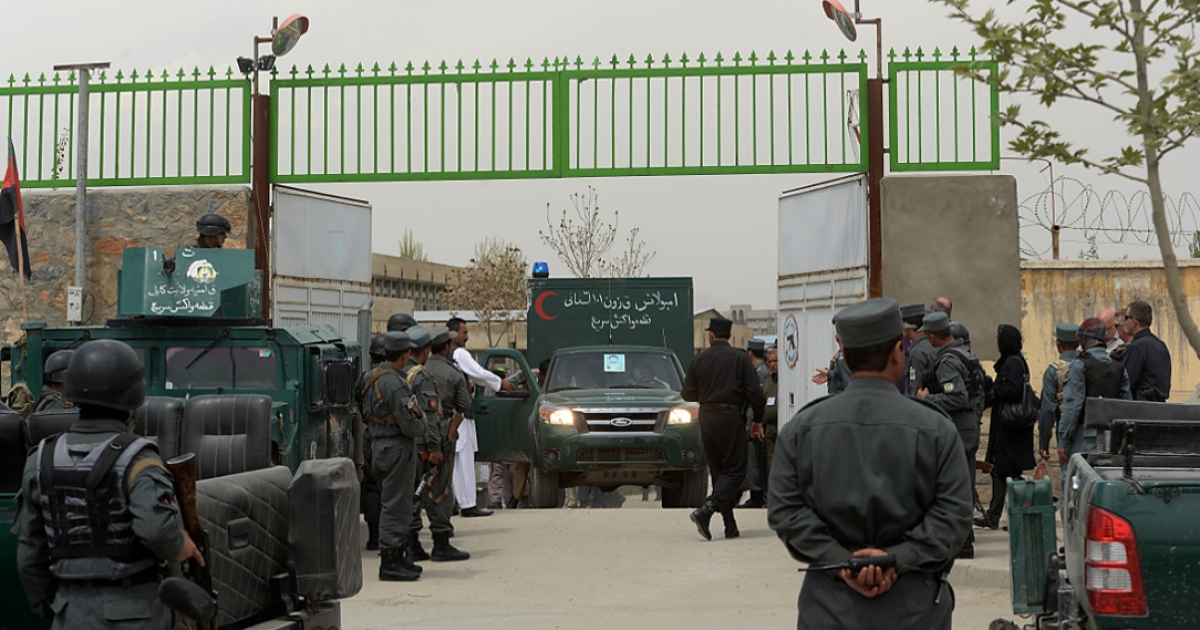 An ambulance carrying victims of a shooting at the gate of the Cure hospital in Kabul, Afghanistan on April 24, 2014.</p>