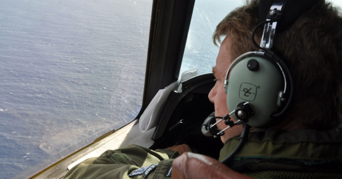 This photo taken on April 1, 2014 shows Royal New Zealand Air Force (RNZAF) P3 Orion Rescue Flight 795 searching for the missing Malaysia Airlines flight MH370 over the Indian Ocean.</p>