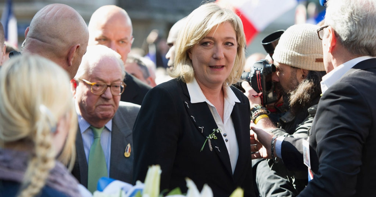 Marine Le Pen arrives to lay down flowers in front of a statue of Jeanne D'Arc as part of Far Right Party May Day demonstration on May 1, 2012 in Paris, France.</p>