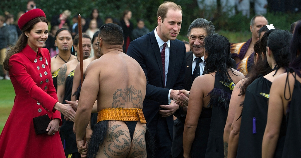 Britain's Prince William (C) and his wife Catherine (L) meet a Maori performance group during a welcoming ceremony at Government House in Wellington, New Zealand, on April 7, 2014.</p>
