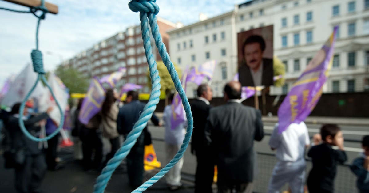 Mock nooses are displayed as supporters of the People's Mojahedin Organization of Iran take part in a demonstration outside the Iranian embassy in London on July 31, 2010.</p>