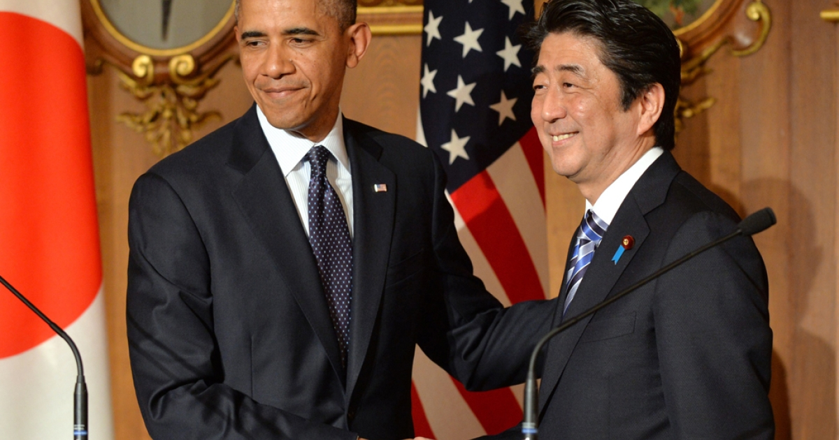US President Barack Obama (L) shakes hands with Japanese Prime Minister Shinzo Abe following a bilateral press conference at the Akasaka Palace in Tokyo on April 24, 2014.</p>