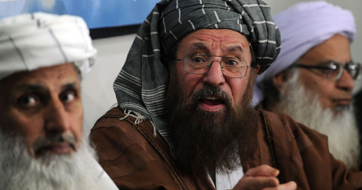 Members of a committee from Tehreek-e-Taliban Pakistan speak with media representatives in Islamabad on Feb. 4, 2014.</p>