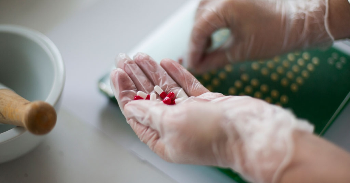 A nurse makes specific pills at the pharmacy of the Argenteuil hospital, in a Paris suburb, on July 23, 2013.</p>