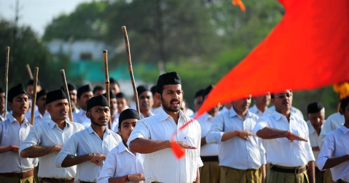 Indian members of the Hindu nationalist Rashtriya Swayamsevak Sangh (RSS) march to mark the upcoming Hindu New Year in Allahabad on March 30, 2014.</p>
