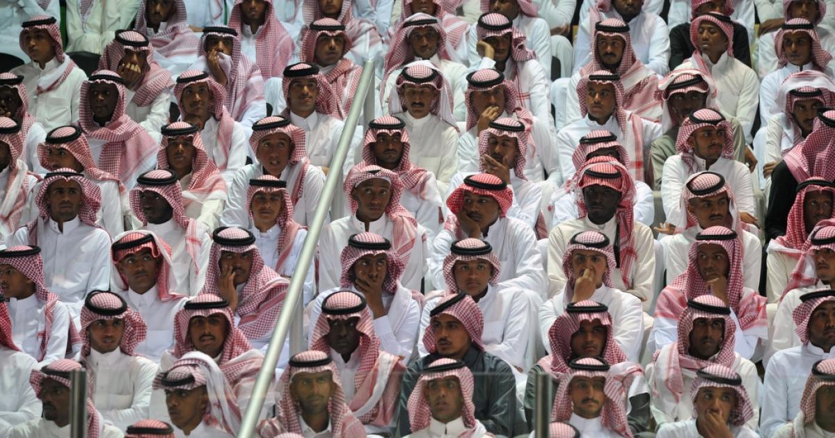 Saudi men attend a traditional dance during Janadriya, a national cultural and heritage festival, near Riyadh on Feb. 18, 2014.</p>