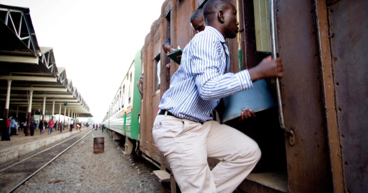 A man boards the Nairobi-Mombasa train in Kenya.</p>