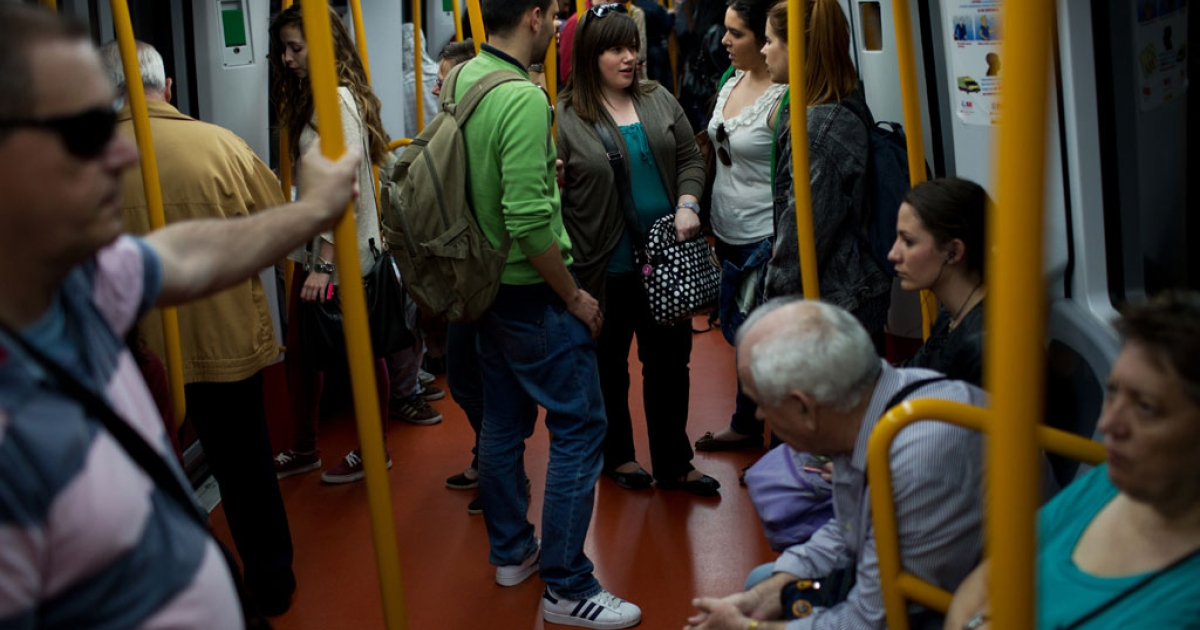 Students in Madrid travel by metro after their daily Dutch language class preparing them for their move from Spain to the Netherlands.</p>