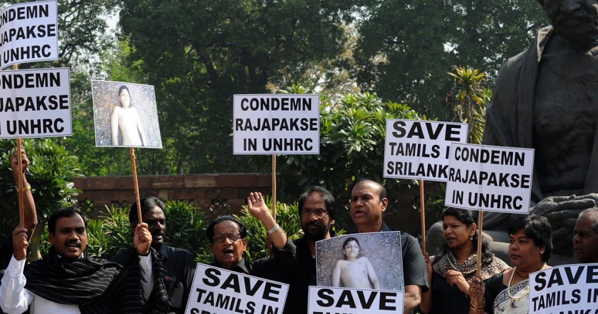Dravida Munnetra Kazhagam members condemn the killing of Tamilians in Sri Lanka at a protest in New Delhi on March 5, 2013.</p>
