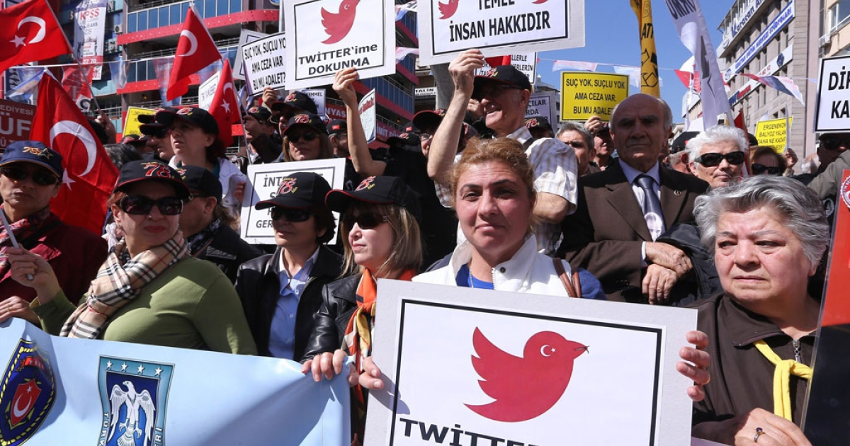 Protesters hold placards reading 'do not touch my twitter ' and 'communication right is a basic human right' during a demonstration against the ban on Twitter during a demonstration against Turkish government in Ankara on March 22, 2014.</p>