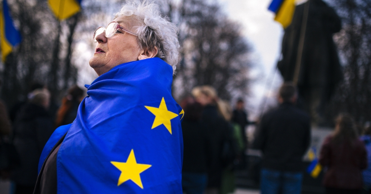 Don't get your hopes up: A woman wrapped in an EU flag at a pro-Ukraine rally in the eastern city of Lugansk on Tuesday.</p>