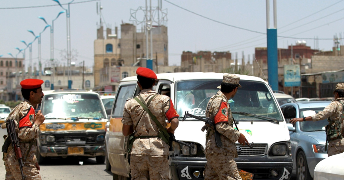 Yemeni soldiers stand guard in the capital Sanaa on April 20, 2014, as they check passing vehicles as authorities tightened security measures a day after a US drone killed 15 Al Qaeda suspects.</p>