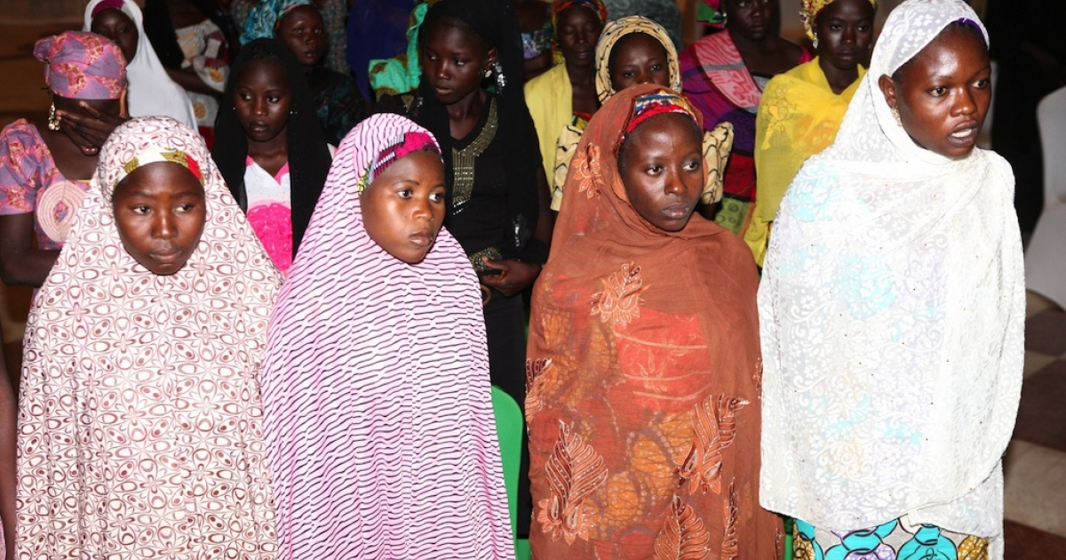 Some of the Chibok schoolgirls who escaped their Boko Haram Islamist captors wait to meet the Nigerian president at the presidency in Abuja on July 22, 2014.</p>
