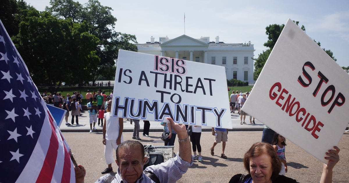 Demonstrators at a rally supporting Kurdistan hold placards protesting against the Islamic State in front of the White House on August 16.</p>