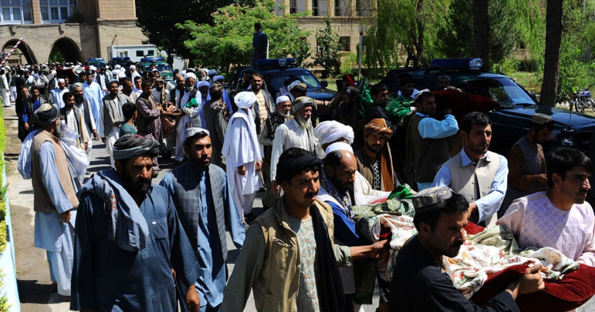 Afghan mourners and demonstrators carry the bodies of civilians allegedly killed in a NATO-led ISAF air strike in Herat on Aug. 5, 2014.</p>