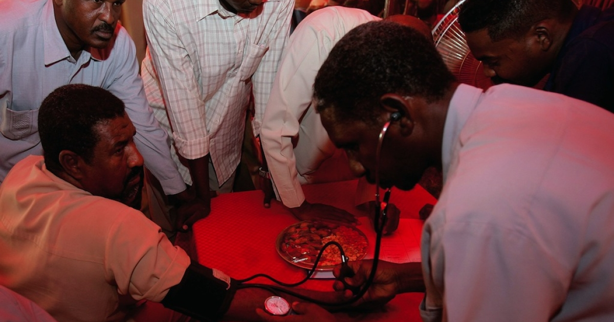 A doctor reads a man's blood pressure on April 19, 2012 at a temporary blood clinic in Sudan. Chronic diseases will account for a quarter of deaths in Africa by 2015, as per WHO estimates.</p>