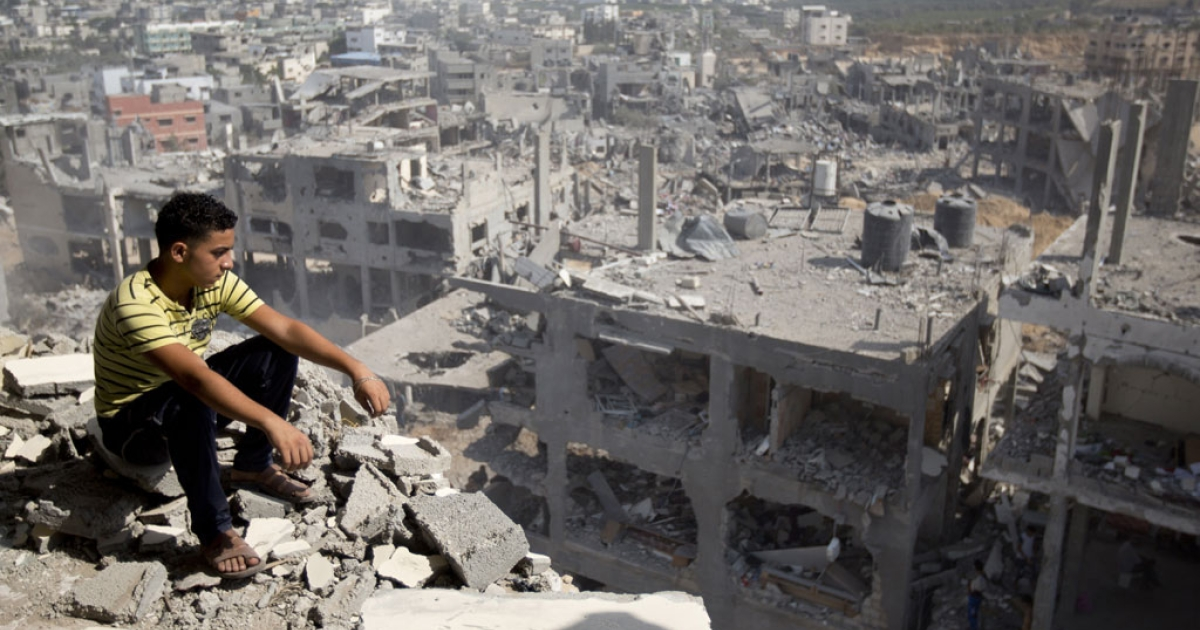 A Palestinian man looks out over destruction in part of Gaza City's al-Tufah neighborhood on Aug. 6, 2014.</p>