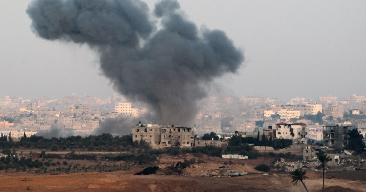 A picture taken from the Israeli side of the Israel-Gaza Border on Aug. 21, 2014, shows smoke and dust rising from the coastal side of the Gaza strip following an Israeli military strike.</p>