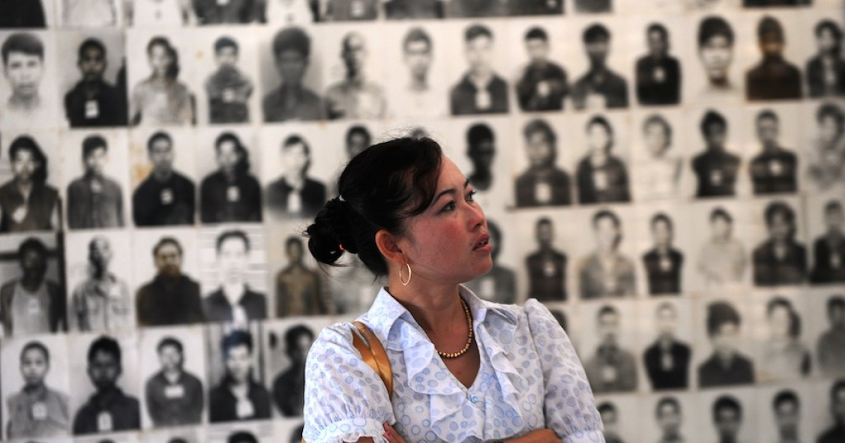A Cambodian woman looks at portraits of victims of the Khmer Rouge at the Tuol Sleng genocide museum in Phnom Penh. While the regime's crimes are commonly referred to as