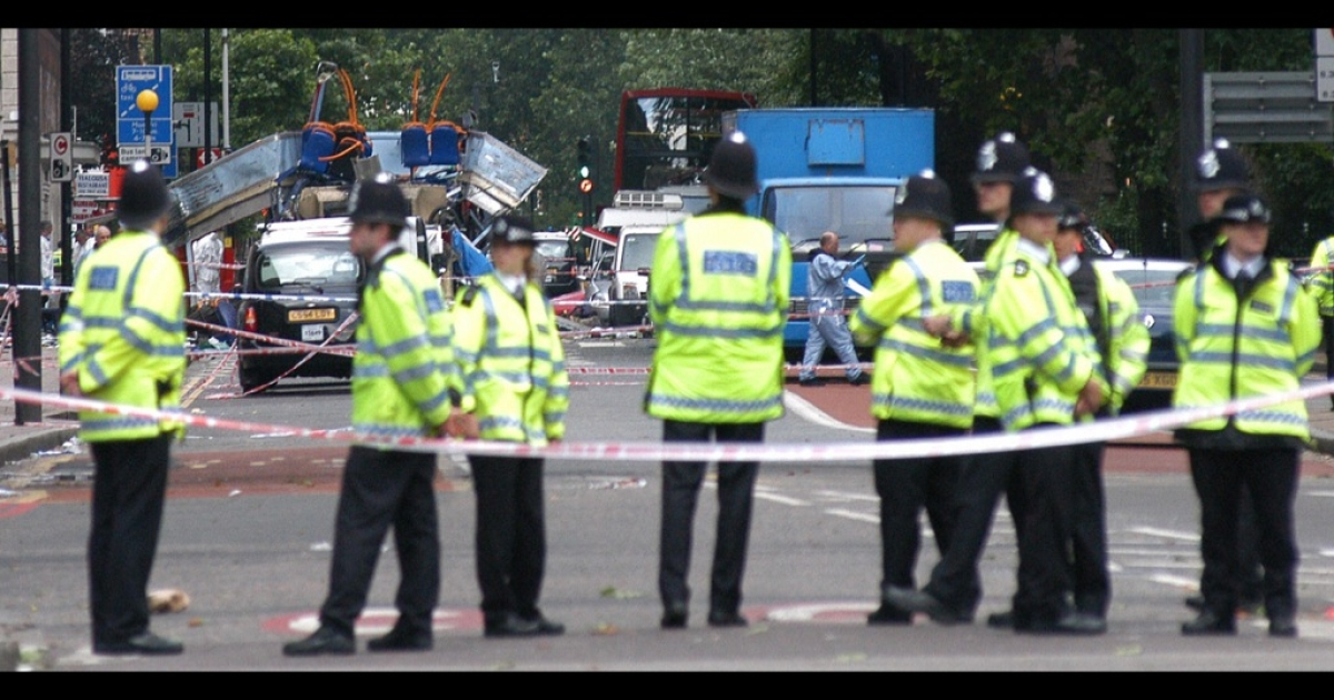 Police block access to a bus destroyed by a bomb in London on July 7, 2005. Explosions ripped through three underground trains, as well.</p>