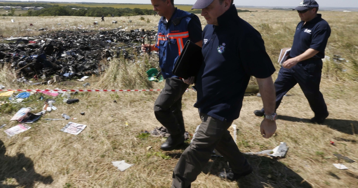 International experts at the MH17 crash site near the village of Hrabove on Friday.</p>