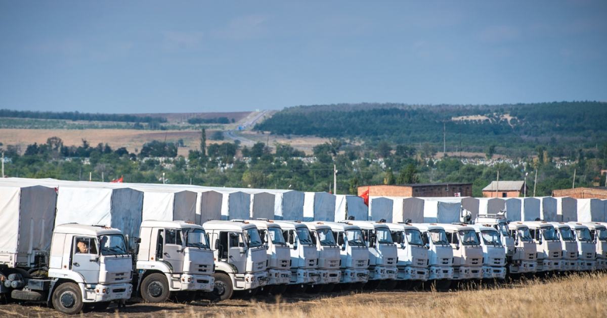 A Russian humanitarian convoy is parked near a checkpoint at the Ukrainian border outside the town of Kamensk-Shakhtinsky in the Rostov region, Aug. 20, 2014.</p>