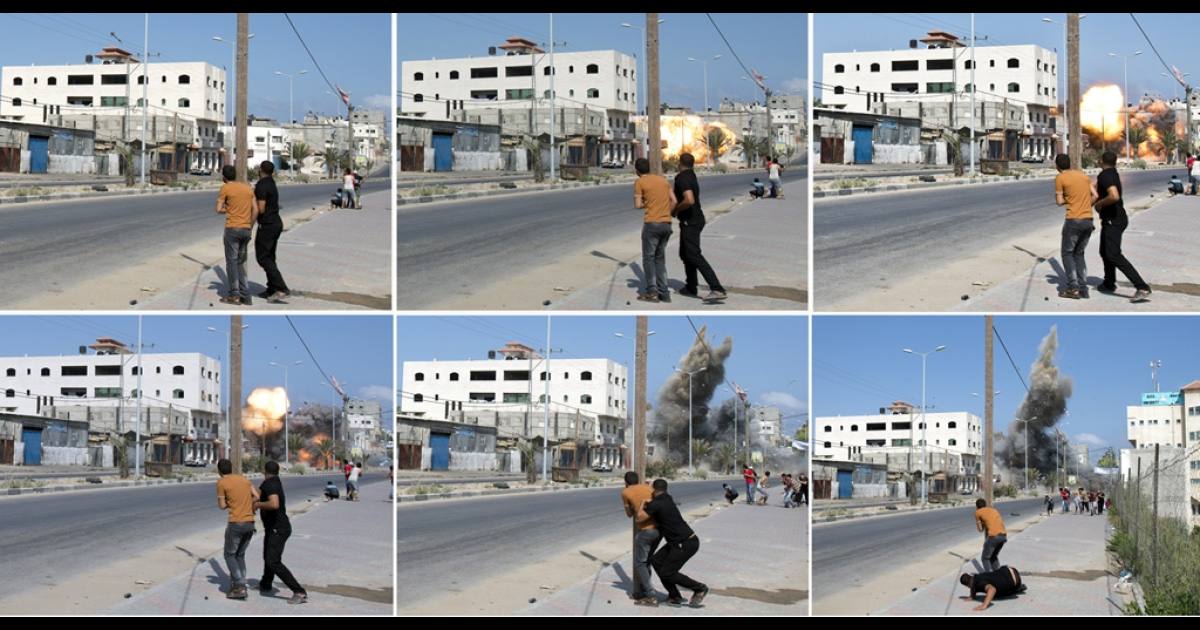 A combination of pictures taken in Gaza City on Aug. 23, 2014 shows Palestinian men watching and then running as an Israeli bomb hits its target in the Palestinian enclave.</p>
