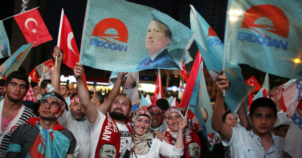 Supporters of Turkey's Tayyip Erdogan celebrate his presidential election victory in front of the party headquarters in Ankara Aug. 10.</p>