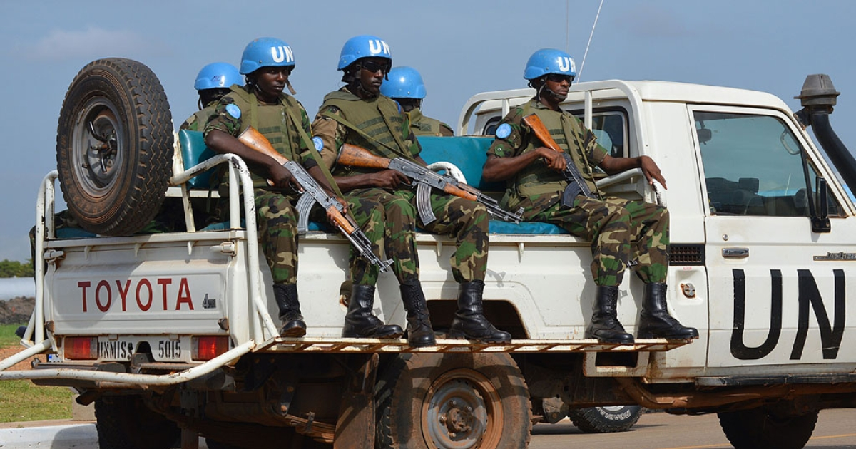 UN peace keepers secure a section of the airport on Aug. 12, 2014 as members of the United Nations Security Council arrive in the South Sudanese capital, Juba.</p>