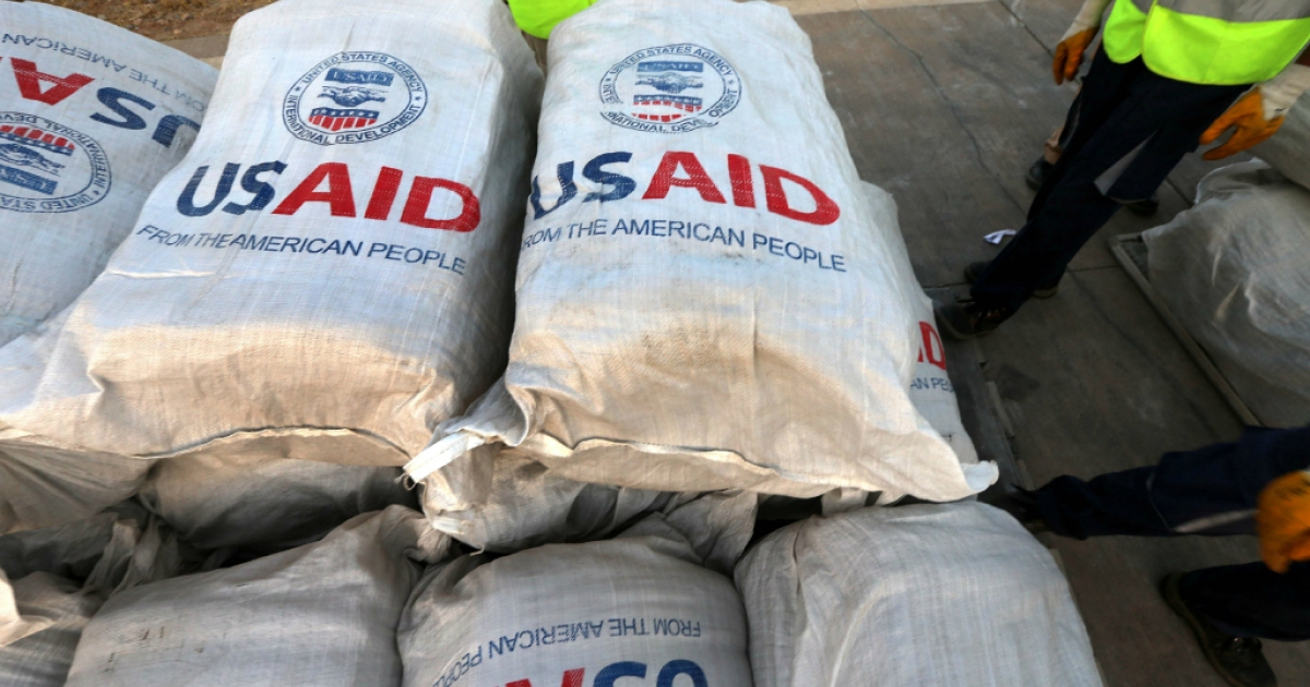 Airport personnel check humanitarian supplies after 60 tons of aid from USAID were unloaded from a plane at the airport in Arbil, the capital of the autonomous Kurdish region of northern Iraq.</p>