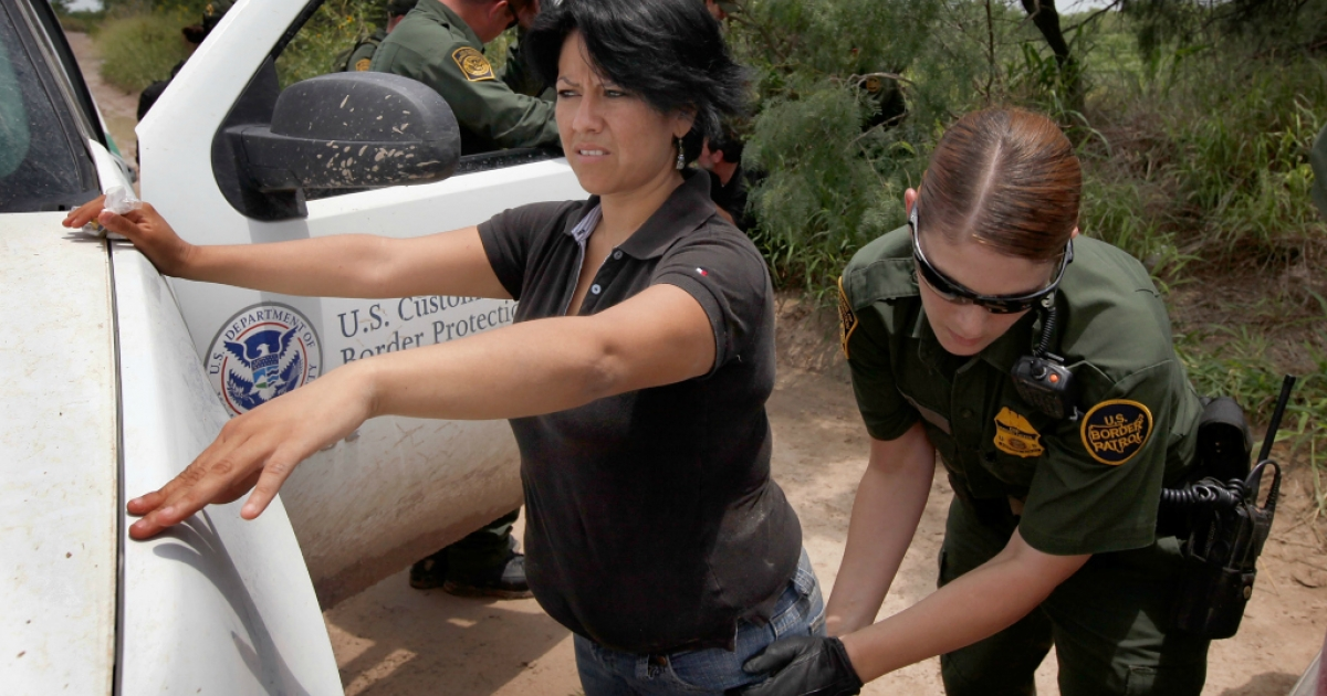 A Border Patrol agent searches an undocumented immigrant apprehended near the Mexican border on May 27, 2010 near McAllen, Texas.</p>