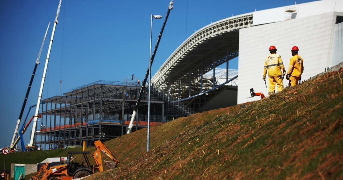Construction work continues on temporary seating at the Itaquerao stadium, also known as Arena de Sao Paulo and Arena Corinthians, on April 29, 2014 in Sao Paulo, Brazil. The stadium is scheduled to host the opening World Cup match on June 12 between Brazil and Croatia.</p>