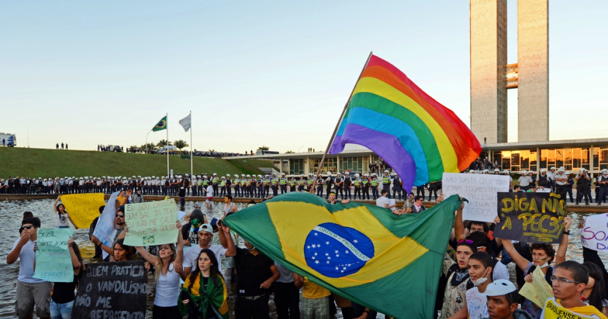 Students take part in a protest against corruption and price hikes at the National Congress in Brasilia on June 20, 2013.</p>