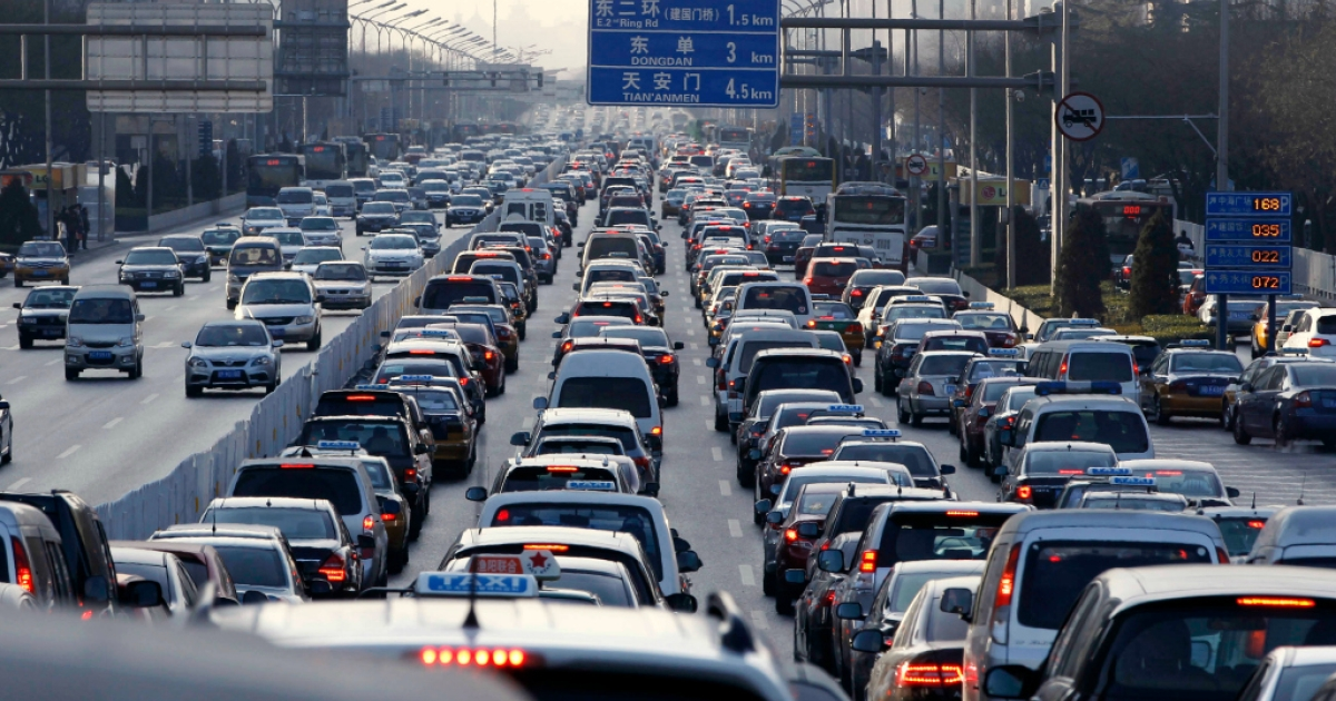 Vehicles are seen in a traffic jam during weekday rush hour in Beijing on January 10, 2011.</p>