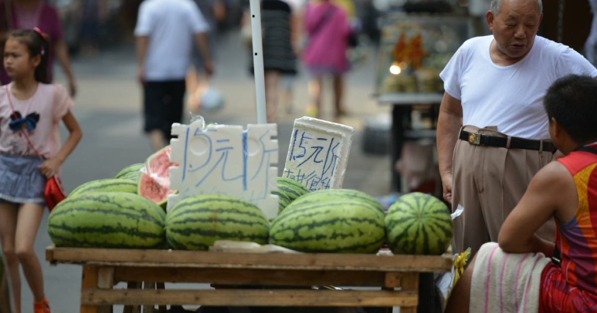 Watermelons are displayed for sale in Shanghai on July 16, 2013.</p>