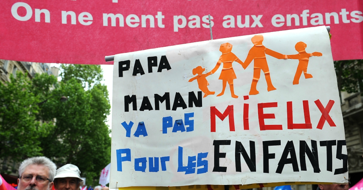 PARIS, FRANCE - Anti-same sex marriage activists of the movement 'La Manif Pour Tous' protest during a demonstration on May 26, 2013.</p>