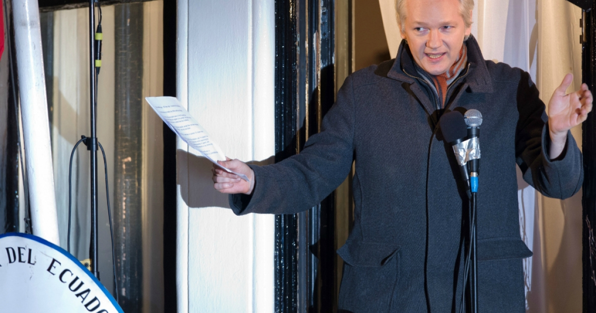 In this file picture taken on December 20, 2012, Wikileaks founder Julian Assange addresses members of the media and supporters from the window of the Ecuadorian embassy in London.</p>