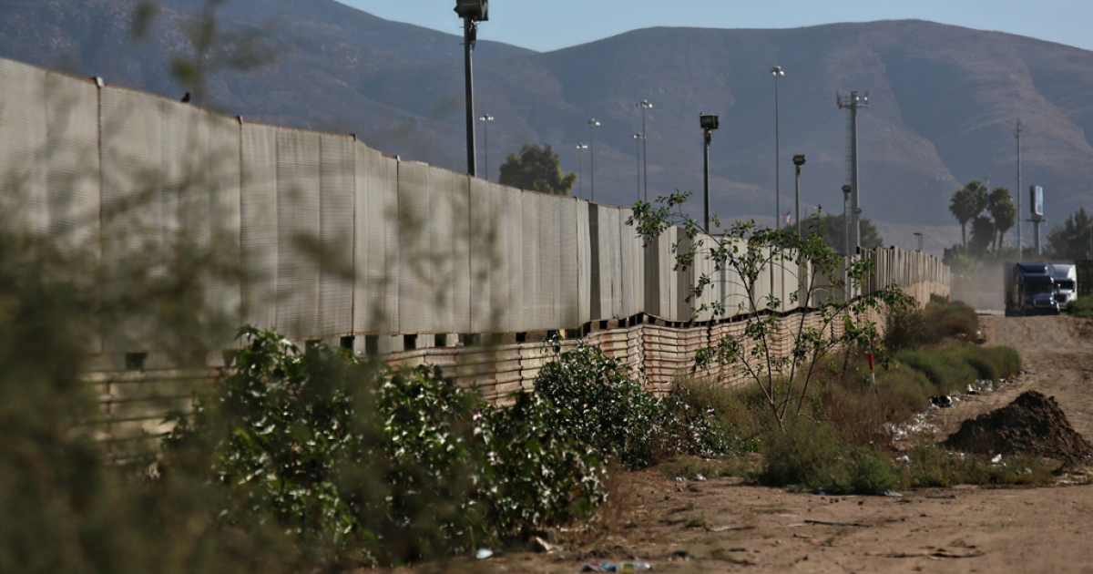 TIJUANA, MEXICO - The border wall stands approximately 100 yards from a factory where a drug tunnel was discovered leading into the United States in October of 2013.</p>
