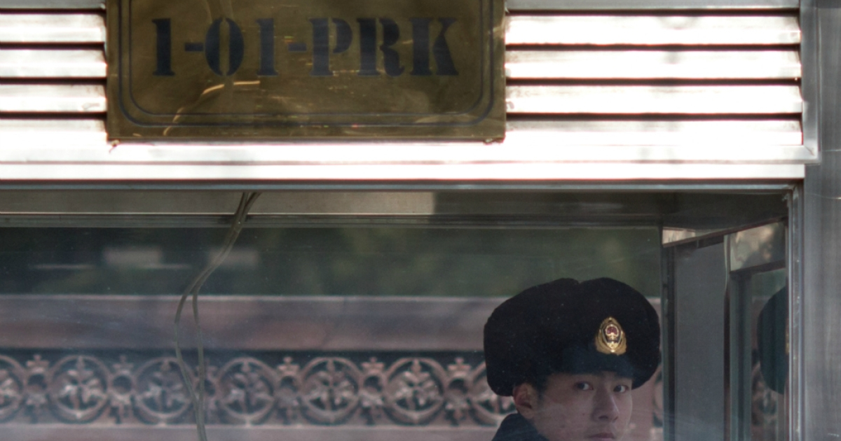 A Chinese paramilitary guard stands on duty outside the North Korean embassy in Beijing on February 12, 2013.</p>
