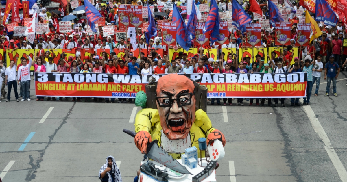 Thousands of anti-government protestors march in the streets of Quezon City during Philippine President Benigno Aquino III's state of the nation address on July 22, 2013.</p>