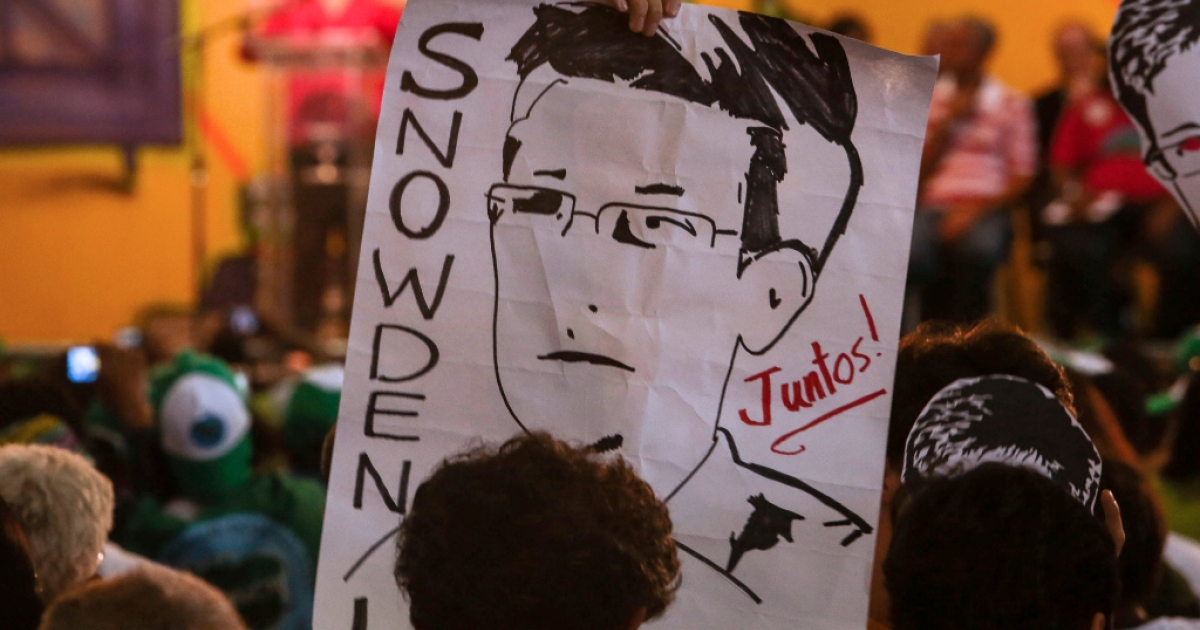 Activists take part in a demonstration asking Brazilian President Dilma Rousseff to grant Edward Snowden political asylum.</p>
