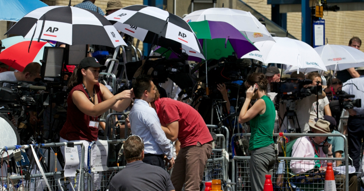 Media personnel gather outside St Mary's hospital in central London, on July 22, 2013.</p>