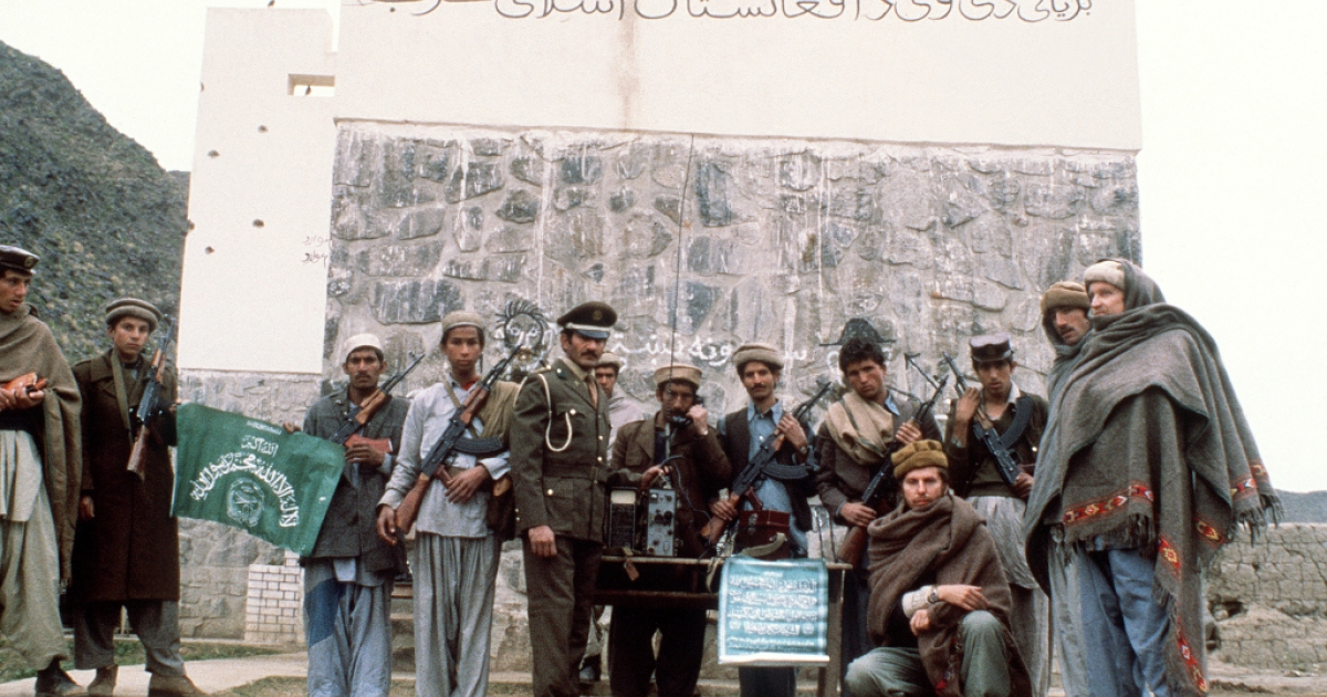 Afghan anti-Soviet resistance fighters of the biggest political party of Afghanistan Hizbi Islam stand in front of their fort in the mountainous Khunar area near Pakistani border in Afghanistan on February 28, 1980. The Afghans repulsed the then Red Army 1979-1989 invasion with a huge human cost and with the material aid of the western wolrd, above all, the United States. Easy estimates say that around one and half million Afghans were killed in their fight against the Soviet soldiers.        (Photo credit should read /AFP/Getty Images)</p>