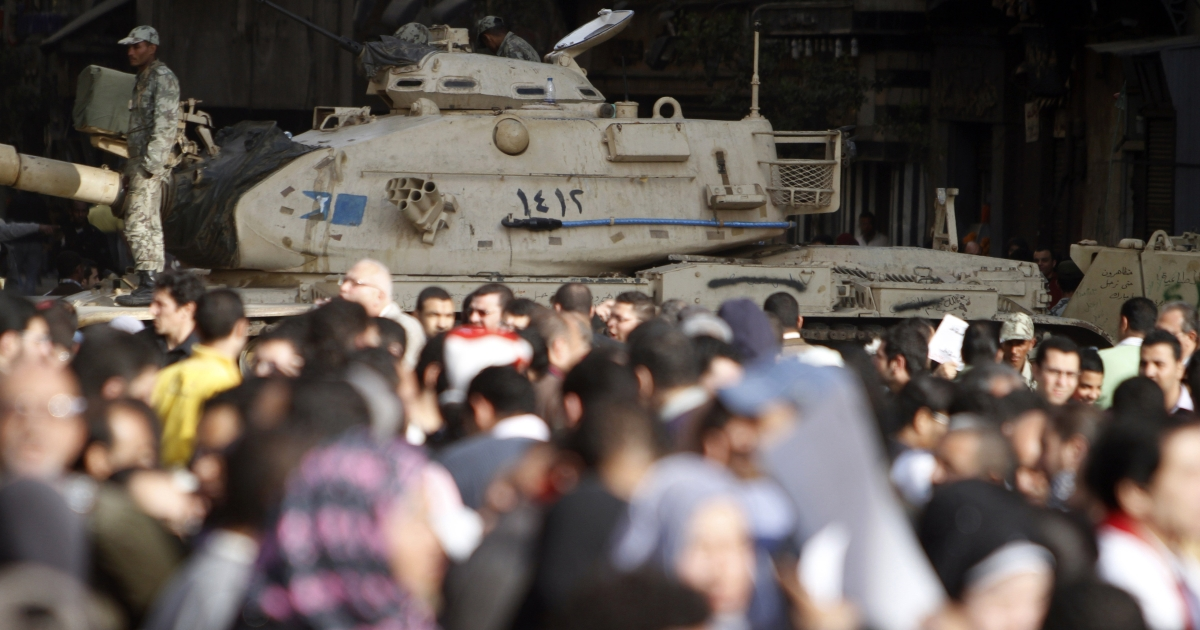 Egyptian demonstrators gather in Tahrir Square close to a military tank in 2011. The military has long been the true arbiter of power in Egypt.</p>