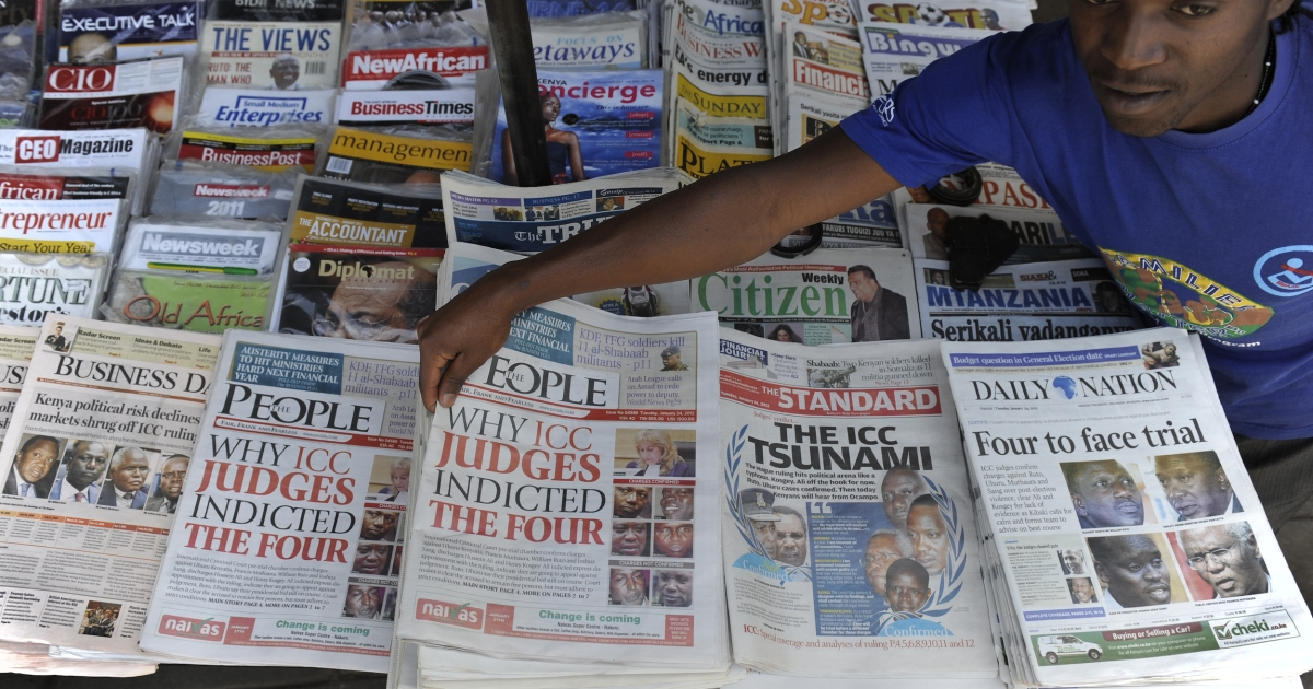 A Nairobi newspaper vendor sells papers announcing the four Kenyans to face charges of crimes against humanity before the International Criminal Court, January 24 2012 . Kenya's then-deputy prime minister, Uhuru Kenyatta and another presidential hopeful, William Ruto, were among the four suspects named by the ICC.</p>
