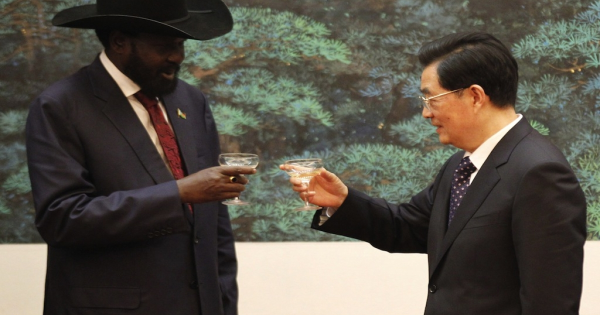 South Sudan president Salva Kiir (L) and Chinese president Hu Jintao toast each other during a signing ceremony at Great Hall of the People on April 24, 2012 in Beijing, China. President Kiir confirmed that he sees China as an important and strategic partner, while the meeting was held against a backdrop of recent violence between the the newly formed independent nation of South Sudan and Sudan, both countries from which China purchases oil.</p>