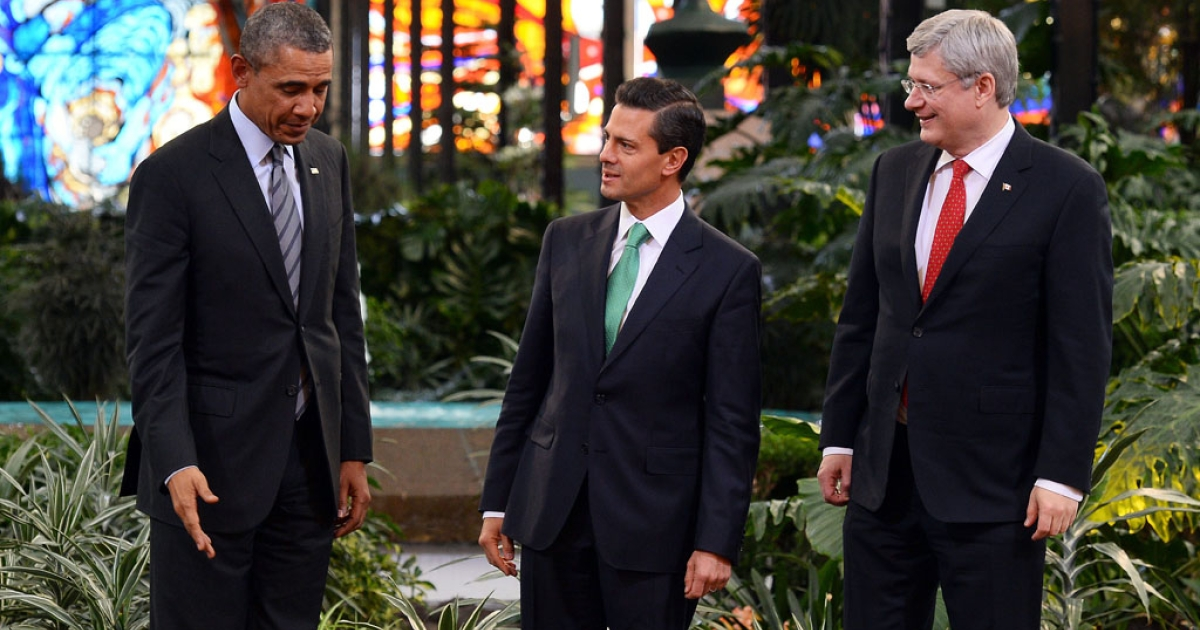 President Barack Obama, left, Mexican President Enrique Pena Nieto and Canadian Prime Minister Stephen Harper pose in Toluca, Mexico, on February 19, 2014.</p>