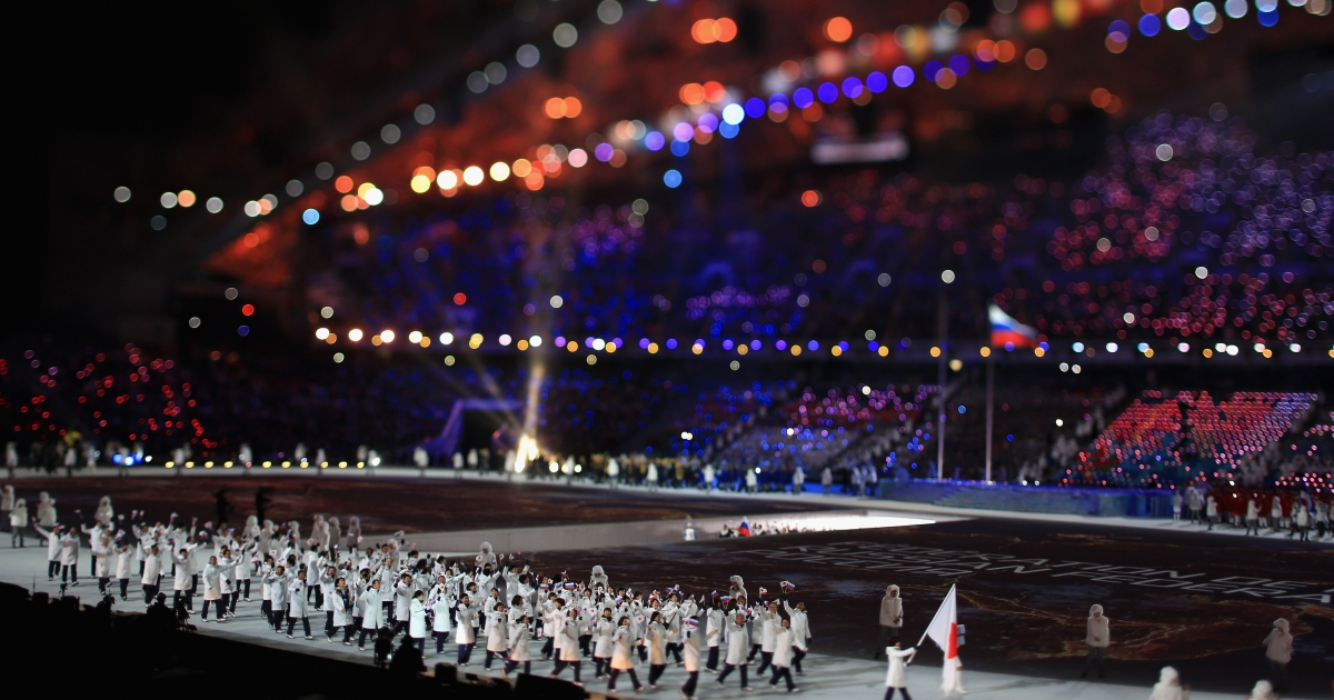 The Japanese team enter during the Opening Ceremony of the Sochi 2014 Winter Olympics</p>