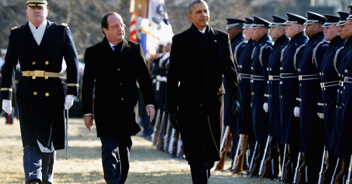 U.S. President Barack Obama and French President Francois Hollande during a welcoming ceremony on the South Lawn at the White House on February 11, 2014 in Washington, DC. Hollande who arrived yesterday for a three day state visit, visited Thomas Jefferson's Monticello estate and will be the guest of honor for a state dinner tonight.</p>