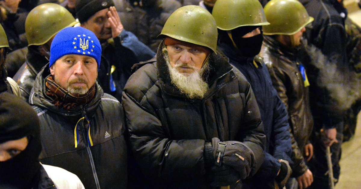 Activists of 'Maidan self-defence' guard Kiev's city hall in order to prevent its capture by other anti-government activists during their confrontation in Kiev, on February 16, 2014.</p>